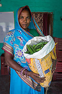 A producer group farmer carries a bag of okra that she has harvested to be sold in the collection centre in Machahi village, Muzaffarpur, Bihar, India on October 27th, 2016. Non-profit organisation Technoserve works with women vegetable farmers in Muzaffarpur, providing technical support in forward linkage, streamlining their business models and linking them directly to an international market through Electronic Trading Platforms. Photograph by Suzanne Lee for Technoserve