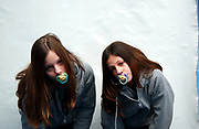 Two girls with dummies in their mouths