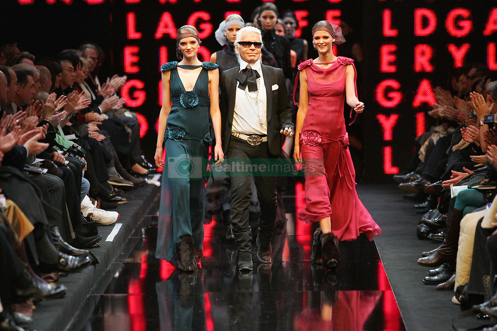 German fashion designer Karl Lagerfeld with models walks on the runway after the Lagerfeld Gallery Fall-Winter 2005-2006 ready-to-wear collection presentation in Paris, France, on March 2, 2005. Photo by Java/ABACA.