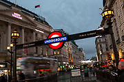 Beneath the Trocadero is London Underground's roundel, located at the entrance to Piccadilly Circus underground station, on 22nd November 2019, in Westminster, London, England.