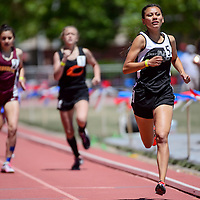 Navajo Prep Eagle Sarah Chacon pulls ahead in the final straightaway to win the 800 meter run in the New Mexico State track and field meet in Albuquerque Saturday.