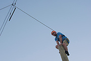 Male balancing on beam at the College of Southern Idaho Challenge Rope Course Twin Falls, Idaho.