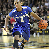 Memphis guard Charles Carmouche (4) during a Conference USA NCAA basketball game between the Memphis Tigers and the Central Florida Knights at the UCF Arena on February 9, 2011 in Orlando, Florida. Memphis won the game 63-62. (AP Photo: Alex Menendez)