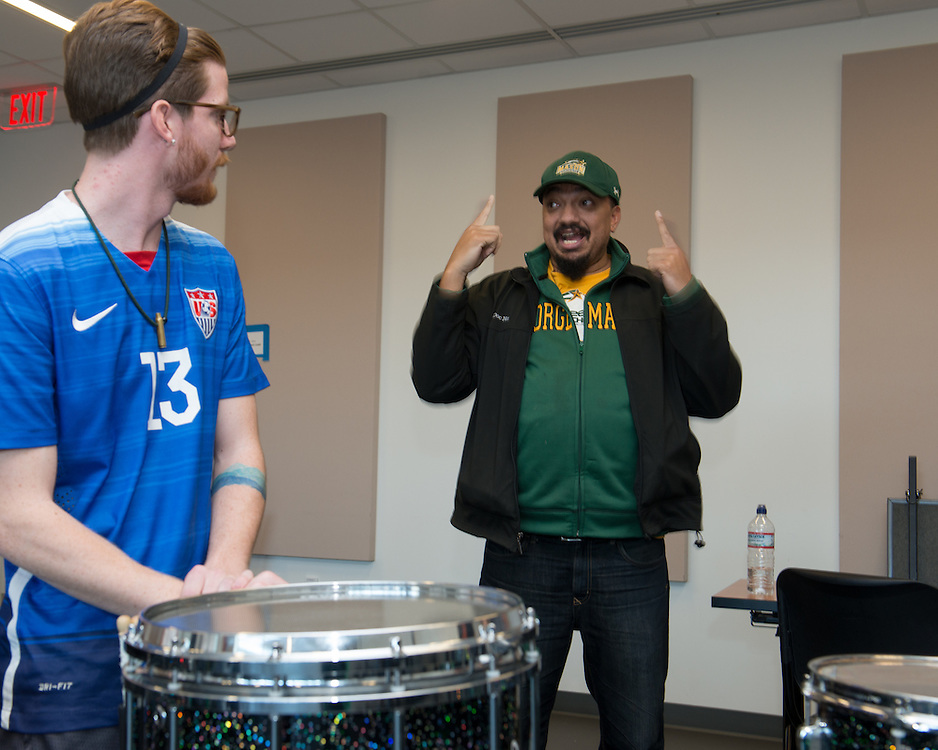 December 5, 2015 - Fairfax, VA - A day in the life of &quot;Doc Nix,&quot; aka Dr. Michael Nickens, the Director of the Athletic Bands for George Mason University. Here Doc Nix meets with the percussion unit for a few words of advice.<br /> <br /> Photo by Susana Raab