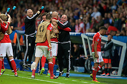 LILLE, FRANCE - Friday, July 1, 2016: Wales substitutes celebrate the third goal to make the score 3-1 during the UEFA Euro 2016 Championship Quarter-Final match against Belgium at the Stade Pierre Mauroy. Sean Connelly, Ian Mitchell. (Pic by Paul Greenwood/Propaganda)