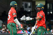 Shakib Al Hasan (vc) of Bangladesh and Liton Das of Bangladesh touch gloves during the ICC Cricket World Cup 2019 match between Pakistan and Bangladesh at Lord's Cricket Ground, St John's Wood, United Kingdom on 5 July 2019.