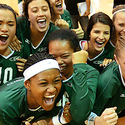 November 07, 2014:   Golden West College Womens Volleyball Players celebrate after a 3-0 sweep of the Orange Coast College Pirates womens Volleyball team. Sports Shooter Academy XI
