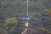 JIAOZUO, CHINA - NOVEMBER 06: <br /> <br /> French slackliner Theo Sanson walks backwards on a slackline during a challenge at Yuntai Mountain on November 6, 2016 in Jiaozuo, Henan Province of China. French slackliner Theo Sanson have made the Guinness World Records of the fast 100 m slacklining backwards walk at Yuntai Mountain in Jiaozuo on November 6. <br /> ©Exclusivepix Media