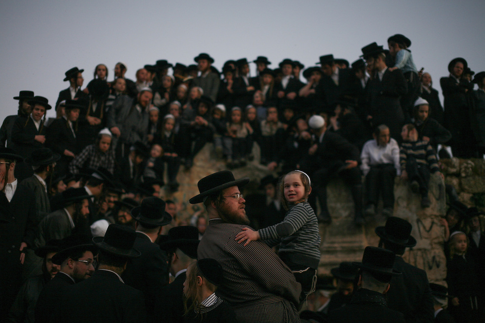 Ultra-Orthodox Jews collect water from a mountain spring near Jerusalem on March 24, 2013 to be used in baking the unleavened bread, known as matzoth, during the Maim Shelanu (Rested Water) ceremony.