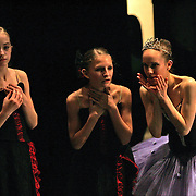 Young dancers talk backstage during rehearsal of the Nutcracker Ballet in Des Moines, Iowa.