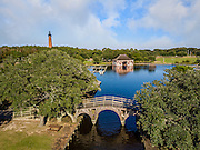 Wooden bridge, boathouse, and Currituck Beach Lighthouse in Corolla NC.