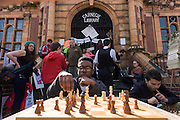 Campaigners protesting about the closed Carnegie Library play chess outside, in Herne Hill, south London on 2nd April 2016. The angry local community in the south London borough have occupied their important resource for learning and social hub for the weekend. After a long campaign by locals, Lambeth have gone ahead and closed the library's doors for the last time because they say, cuts to their budget mean millions must be saved. A gym will replace the working library and while some of the 20,000 books on shelves will remain, no librarians will be present to administer it. London borough's budget cuts mean four of its 10 libraries will either close, move or be run by volunteers.