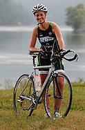 Chattanooga Triathlon Club member Noel Kahl Reagan rides her TT bike along Raccoon Mountain Road adjacent to the Tennessee River on June 5, 2013. Reagan recently completed her first half-ironman triathlon and is already considering another. © Dan Henry / BiciPhoto.com