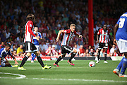 Konstantin Kerschbaumer winning the bal in the middle of the park during the Sky Bet Championship match between Brentford and Ipswich Town at Griffin Park, London, England on 8 August 2015. Photo by Matthew Redman.
