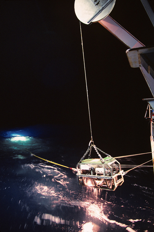 USA, Crew retrieves remote sub onto deck of R/V Thomas G. Thompson in North Pacific Ocean off Washington coast