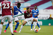 Dwight McNeil of Burnley (11) shields the ball from Brighton and Hove Albion midfielder Yves Bissouma (8)  during the Premier League match between Burnley and Brighton and Hove Albion at Turf Moor, Burnley, England on 26 July 2020.