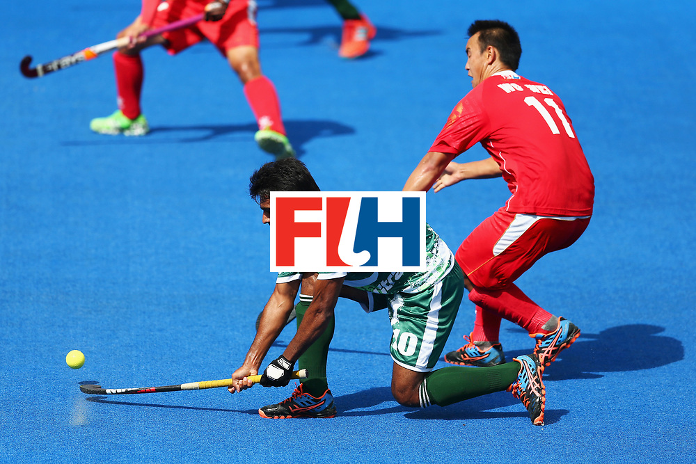 LONDON, ENGLAND - JUNE 25:  Ali Shan of Pakistan shoots while under pressure from Wei Wo of China during the 7th/8th place match between Pakistan and China on day nine of the Hero Hockey World League Semi-Final at Lee Valley Hockey and Tennis Centre on June 25, 2017 in London, England.  (Photo by Steve Bardens/Getty Images)