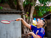 20 MAY 2017 - BANGKOK, THAILAND:  A boy who lives in Pom Mahakan plays badminton in the new park in Pom Mahakan.  The park was built after the families living on the site were evicted and their homes razed. The final evictions of the remaining families in Pom Mahakan, a slum community in a 19th century fort in Bangkok, have started. City officials are moving the residents out of the fort. NGOs and historic preservation organizations protested the city's action but city officials did not relent and started evicting the remaining families in early March.       PHOTO BY JACK KURTZ