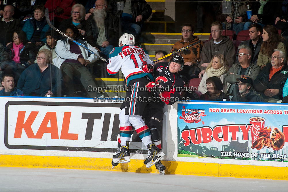 KELOWNA, CANADA - MARCH 1:Carsen Twarynski #18 of the Kelowna Rockets checks Shane Collins #19 of the Prince George Cougars into the boards  on MARCH 1, 2017 at Prospera Place in Kelowna, British Columbia, Canada.  (Photo by Marissa Baecker/Shoot the Breeze)  *** Local Caption ***