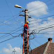 TIMISOARA, ROMANIA - APRIL 21:  A Engineer works at telephone lines in the city centre on April 21, 2013 in Timisoara, Romania.  Romania has abandoned a target deadline of 2015 to switch to the single European currency and will now submit to the European Commission a programme on progress towards the adoption of the Euro, which for the first time will not have a target date. (Photo by Marco Secchi/Getty Images)
