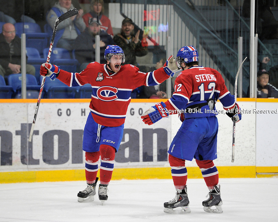 TRENTON, ON - Mar 18 : OJHL North East Conference playoff series round two, Kingston Voyageurs vs Trenton Golden Hawks, Mason Nowak #15 and Michael Stevens #12 celebrate the goal during second period game action<br /> (Photo by Amy Deroche / OJHL Images)