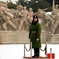 A paramilitary policeman stands guard in front of the Chairman Mao Zedong Mausoleum in Beijing's Tiananmen Square Monday Jan. 21, 2008. Photos: Bernardo De Niz