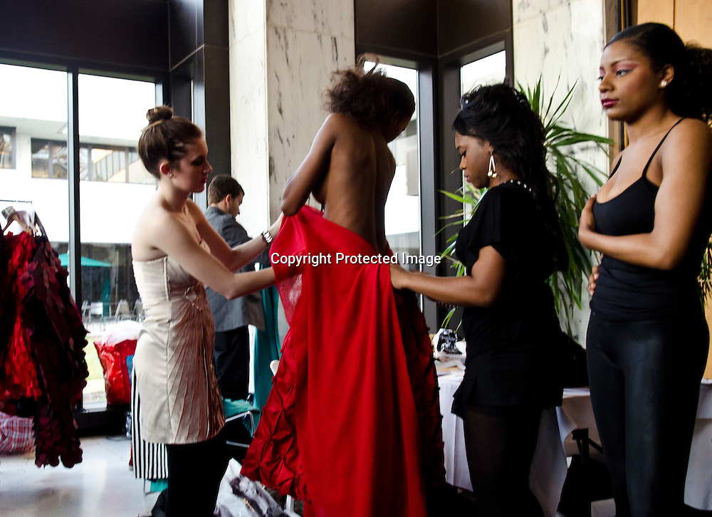 Models backstage during the International Couture Collections show at the French Embassy.