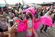"Big Chief Monk Boudreaux and his grandson J'wan Boudreaux of the Golden Eagles Mardi Gras Indians participate in the second line parade after the funeral for Theodore Emile ""Bo"" Dollis, Big Chief of the Wild Magnolias Mardi Gras Indians, at the Xavier Convocation Center on January 31, 2015, in New Orleans, LA. © Erika Goldring - All Rights Reserved."