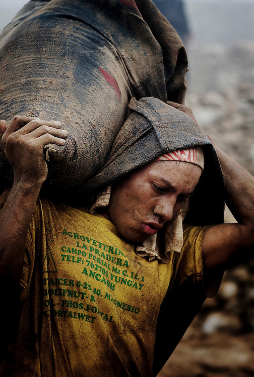 A worker carries a sack of guano in Guañape Norte Island in the coast off Peru, April 2009. The daily task for porters is to carry around 125 sacks of 50kg an average distance of 50mt per worker, so each porter carries 6.25 tons a day.