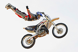 Motocross rider gets airborne in the desert near Phoenix, AZ