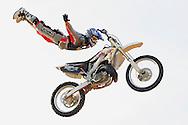 Motocross rider gets airborne in the desert near Phoenix, AZ