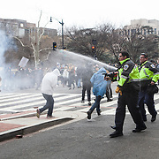 Washington DC, USA, 20 January, 2017. DisruptJ20 protesters are pepper sprayed by police during the inauguration of Donald Trump.