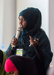 © Licensed to London News Pictures. 4/08/2015. Hargeisa, Somaliland. A young woman asks questions during a panel discussion at the International Hargeisa Book Festival in the city of Hargeisa within the Republic of Somaliland this week (1 - 6 Aug).<br />  <br /> Over 700 guests are expected to attend along with renowned poets, writers and musicians from both Somaliland, Nigeria and the UK.  As well as the book fair the Women of the World (WOW) event, hosted by Jude Kelly, the Artistic Director of the Southbank Centre in London was held for the first time in the Horn of Africa.   Photo credit : Alison Baskerville/LNP