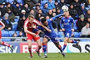 Aaron Amadi-Holloway of Oldham Athletic and Tom Anderson of Chesterfield batt;e for the ball during the Sky Bet League 1 match between Oldham Athletic and Chesterfield at Boundary Park, Oldham, England on 28 March 2016. Photo by Simon Brady.