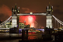 © Licensed to London News Pictures. 11/11/2017. LONDON, UK.  Fireworks explode on the River Thames behind Tower Bridge to mark the finale of the Lord Mayor's Show 2017.  Photo credit: Vickie Flores/LNP