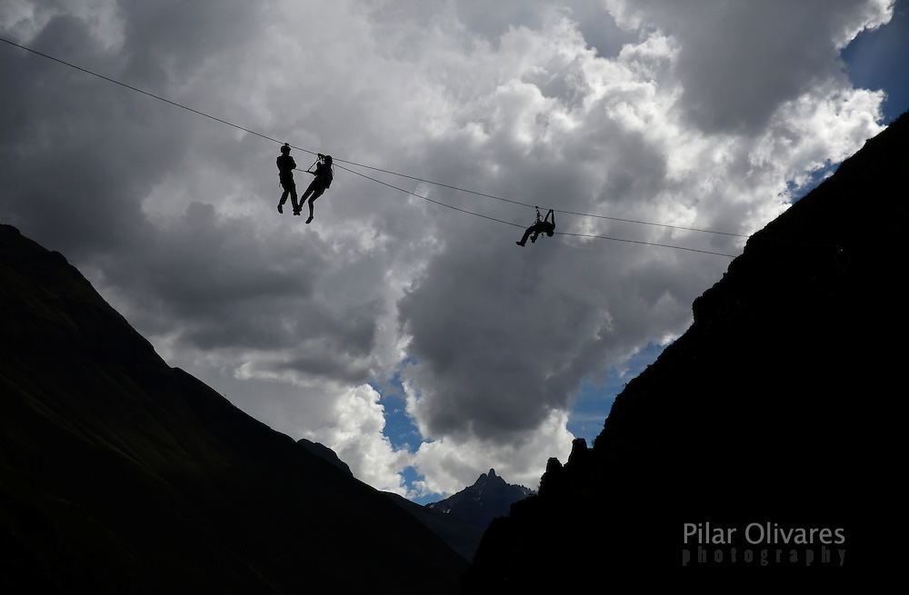 Guests ride a zipline as they leave <br /> the Skylodge Adventure Suites in the Sacred Valley in Cuzco, Peru, August 14, 2015. Tourists taking on an arduous climb up the steep cliff face of Peru's Sacred Valley are being rewarded for their efforts by being able to spend the night in transparent mountaintop sleeping pods at the &quot;Skylodge Adventure Suites&quot;. To reach the pods, visitors need to climb 400 metres of via ferrata (a steel cable and rungs) up the valley side or hike an intrepid trail through zip lines. REUTERS/Pilar Olivares