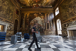 © Licensed to London News Pictures. 25/09/2016. LONDON, UK.  A member of staff removing crates at the Painted Hall. The 300 year old Painted Hall by James Thornhill at the Old Royal Naval College closes today for two years. Major restoration work to remove layers of dirt to the fine dining room will be undertaken in the main hall, ceiling and dome. The project has been awarded a £3.1m Heritage Lottery grant.  Photo credit: Vickie Flores/LNP