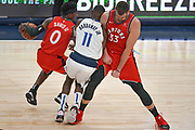 Toronto Raptors center Marc Gasol (33) sets a hard pick on Dallas Mavericks guard Tim Hardaway Jr. (11) while attempting to guard Terence Davis (0) during an NBA basketball game, Saturday, Nov. 16, 2019, in Dallas. The Mavericks defeated the Raptors 110-102. (Wayne Gooden/Image of Sport)