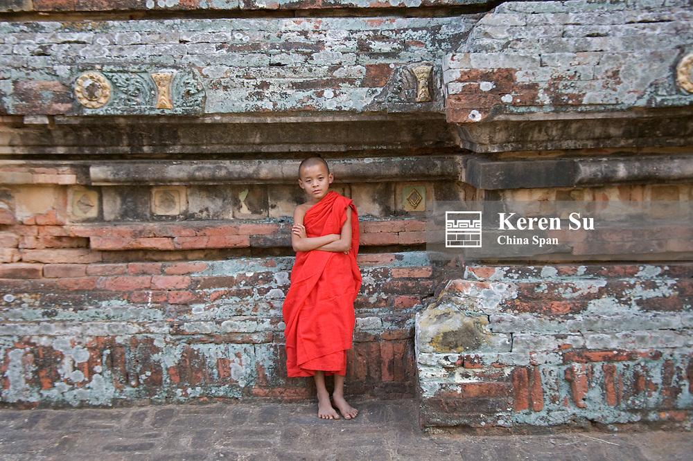 Monk with Htilominlo Temple, Bagan, Myanmar