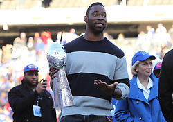Feb 7, 2012; East Rutherford, NJ, USA; New York Giants defensive end Justin Tuck holds the Vince Lombardi Trophy during the New York Giants Super Bowl XLVI Rally at MetLife Stadium.