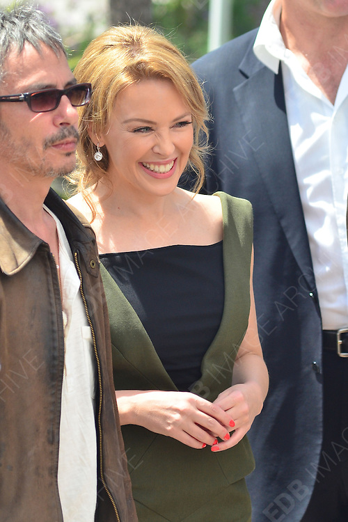 23.MAY.2012. CANNES<br /> <br /> LEOS CARAX AND KYLIE MINOGUE AT THE HOLY MOTORS PHOTOCALL DURING THE 65TH CANNES FILM FESTIVAL 2012, CANNES, FRANCE.<br /> <br /> BYLINE: EDBIMAGEARCHIVE.COM/JOE ALVAREZ <br /> <br /> *THIS IMAGE IS STRICTLY FOR UK NEWSPAPERS AND MAGAZINES ONLY*<br /> *FOR WORLD WIDE SALES AND WEB USE PLEASE CONTACT EDBIMAGEARCHIVE - 0208 954 5968*