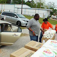 From left, Justin Crosby and Home Depot Foundation volunteers Robert Rorie, Marica Townsend and Latoya Loyd coordinated boxes of supplies for Aberdeen flood victims.