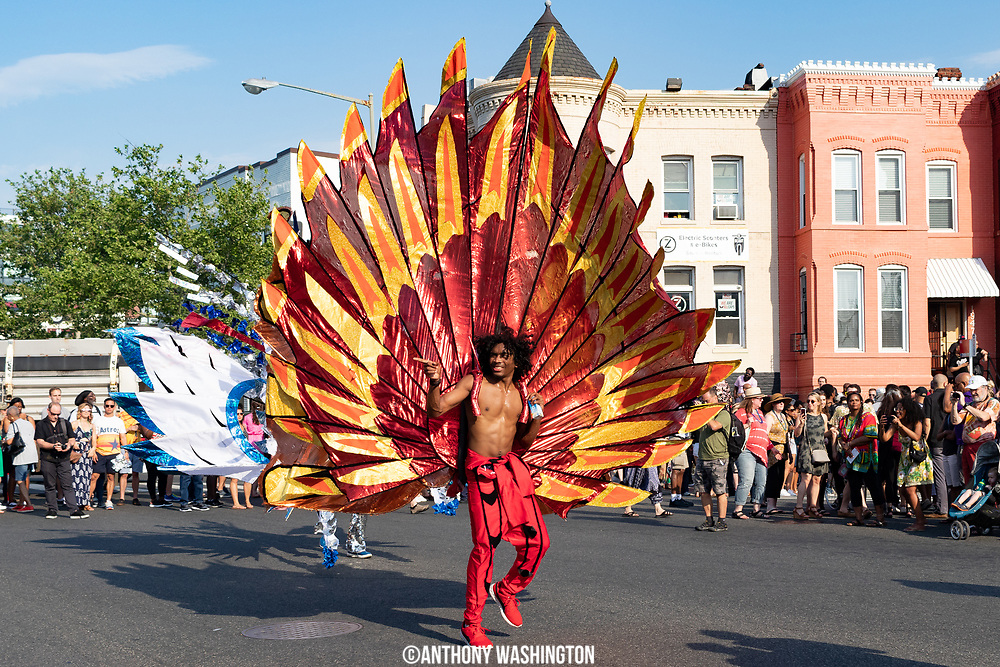 A participant of Funk Parade 2018 heads down U St.in Washington, DC on Saturday, May 12. 2018.