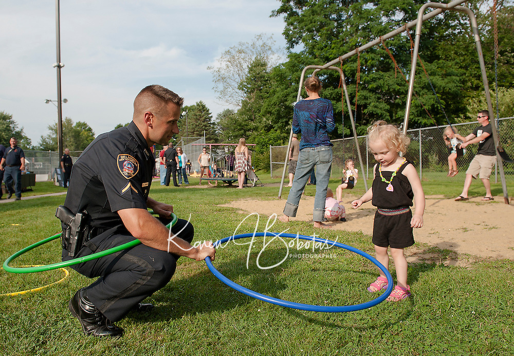 Officer Evan Boulanger and Ashley during Belmont Police Department's National Night Out at Sargent Park on Tuesday evening.  (Karen Bobotas/for the Laconia Daily Sun)