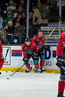 KELOWNA, CANADA - MARCH 16:  Michael Farren #16 and Conner Bruggen-Cate #20 of the Kelowna Rockets take part in a pre game ritual during warm up against the Vancouver Giants on March 16, 2019 at Prospera Place in Kelowna, British Columbia, Canada.  (Photo by Marissa Baecker/Shoot the Breeze)