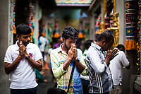 Men during afternoon prayer at Sri Veeramakaliamman Temple in Little India, Singapore.