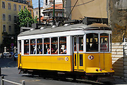 The famous 28 car filled with passengers, part of the historic tram system in Lisbon, Portugal.