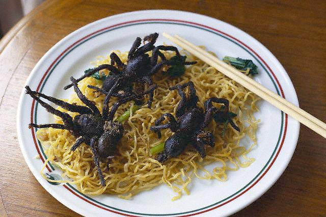 ca. September 1998, Bangkok, Thailand --- A Thai dish of fried tarantulas and noodles in Bangkok. --- Image by © Owen Franken/CORBIS