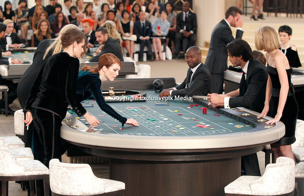 JULIANNE MOORE, KRISTEN STEWART, BAPTISTE GIABICONI and LILY-ROSE DEPP - DEFILE CHANEL - HIGH Coture 2015-2016 FALL-WINTER , THE GRAND PALACE .<br /> &copy;Exclusivepix Media