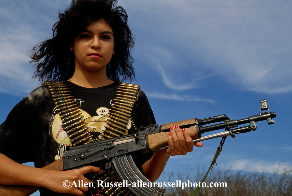 Hispanic woman with AK47 Assault Rifle, South Texas, <br /> MODEL RELEASED